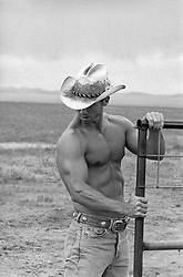 shirtless cowboy on a ranch