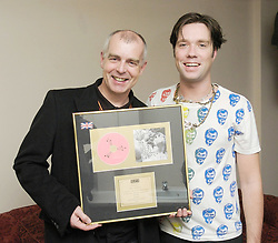 Neil Tennant of The Pet Shop Boys <br /> presented this Gold Album to Rufus Wainwright in recognition of 100,000 sales in the UK of his Album 'Release The Stars' (on the Geffen label). Backstafe at the Hammersmith Apollo, London, Great Britain <br /> 30th October 2007.<br /> <br /> Rufus Wainwright <br /> Neil Tennant <br /> <br /> Photograph by Elliott Franks