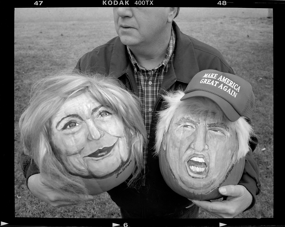 Artist John Kettman poses with decorative pumpkins he created with the painted images of U.S. Democratic presidential candidate Hillary Clinton and Republican Presidential candidate Donald Trump in LaSalle, Illinois, U.S.  Photo by Jim Young