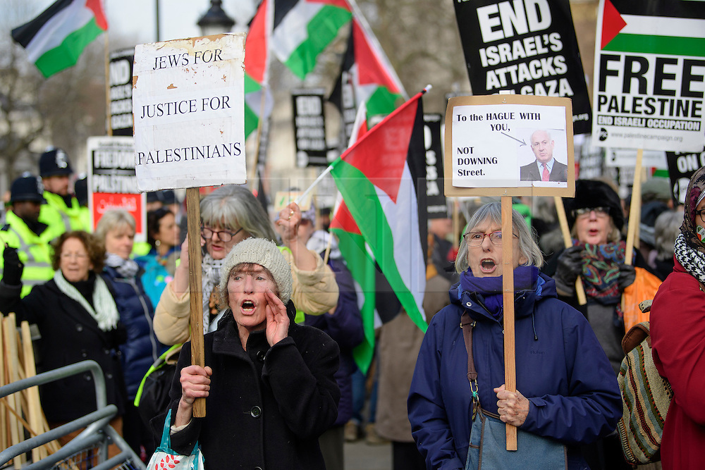 © Licensed to London News Pictures. 06/02/2017. London, UK. Two women take part in an Anti Israeli, pro Palestine demonstration at the gates to Downing Street in London at the time of a meeting between Israeli Prime Minister Benjamin Netanyahu and British Prime Minister Theresa May in Downing Street. Photo credit: Ben Cawthra/LNP