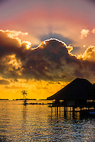 The Sunset Bar with a setting sun in background, Four Seasons Resort Bora Bora, Motu Tehotu, Bora Bora, French Polynesia.