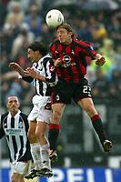 Siena 17/4/2004 Campionato Italiano Serie A <br />30a Giornata - Matchday 30 <br />Siena Milan 1-2 <br />Gianni Guigou (Siena) and Massino Ambrosini (Milan)<br /> Foto Graffiti