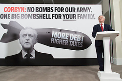 "© Licensed to London News Pictures. 03/05/2017. London, UK. DAVID DAVIES the Secretary of State for Exiting the European Union speak at a General Election Campaign event featuring a poster of Labour party leader JEREMY CORBYN with the slogan ""More debt, higher tax."" Photo credit: Ray Tang/LNP"