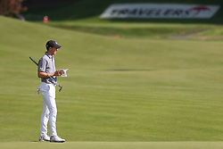 June 21, 2018 - Cromwell, Connecticut, United States - CROMWELL, CT-JUNE 21: Jordan Spieth waits on the 15th green during the first round of the Travelers Championship on June 21, 2018 at TPC River Highlands in Cromwell, Connecticut. (Credit Image: © Debby Wong via ZUMA Wire)