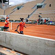 PARIS, FRANCE October 03. Ball boys and ball girls leave  Court Suzanne Lenglen during the French Open Tennis Tournament at Roland Garros on October 3rd 2020 in Paris, France. (Photo by Tim Clayton/Corbis via Getty Images)