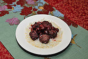 a serving of Meatballs in Cherry sauce on rice