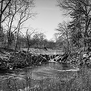 This is from one of my favorite shooting locations.  I thin the black and white treatment helps to bring out the barren and cold aspects of the day