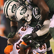 Martellus Bennett, Chicago Bears, is tackled by the New York Jets defense during the New York Jets Vs Chicago Bears, NFL regular season game at MetLife Stadium, East Rutherford, NJ, USA. 22nd September 2014. Photo Tim Clayton for the New York Times