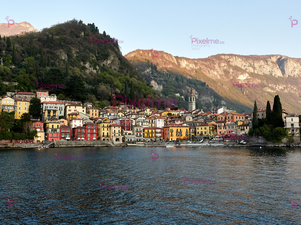 Varenna, Italy  March 30 2019 Lanscape far view of  Varenna Town at Lake Como Italy from Ferry with Bellagio as destination at sunset