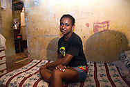 Anaderges de Jesus Souza Vigario Geral 2006. Now 22 Anaderges was 15 years old when I first met her she works as a manicurist and is the proud mother of two year old Jamilly. They live in the same house in Vigario Geral as when I met her back in 2006 14 family members sleep here in a tiny four room house. The house is falling apart and desperately need attention. Anaderges parents are struggling to make improvements due to lack of money and currently neither can work due to health issues. They have a pile of materials to do the work but no money to complete it. Part of the series Viver no Meio do Barulho (Living in the Middle of the Noise)