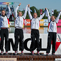 Nicole Reinhardt, Conny Wassmuth, Tina Dietze and Carolin Leonhardt from Germany celebrate their victory in the K1 women Kayak 4x200m relay final of the 2011 ICF World Canoe Sprint Championships held in Szeged, Hungary on August 21, 2011. ATTILA VOLGYI