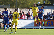 AFC Wimbledon defender Will Nightingale (5) winning header during the EFL Sky Bet League 1 match between AFC Wimbledon and Oxford United at the Cherry Red Records Stadium, Kingston, England on 29 September 2018.