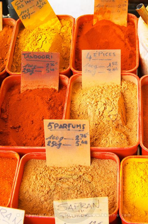 Spice seller at a market. Tandoori, 4 spices, 5 perfumes, saffron,... Collioure. Roussillon. France. Europe.