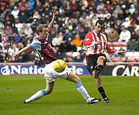 Photo. Glyn Thomas.<br /> Sunderland v Burnley. Nationwide Division 1.<br /> Stadium of Light, Sunderland. 29/11/03.<br /> Sunderland's Julio Arca (R) plays the ball past Tony Grant.