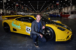 © Licensed to London News Pictures. 18/02/2016. JENSEN BUTTON poses with a  MACLAREN F1 car at the launch of the London Classic Car Show.  The four day event brings together classic car owner, dealers, collectors, experts and enthusiasts. London, UK. Photo credit: Ray Tang/LNP