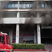 Firefighters arrived to put off a fire in a bank in Panepistimiou street during the the protests in Athens against the  unpopular austerity measures, June 29, 2011