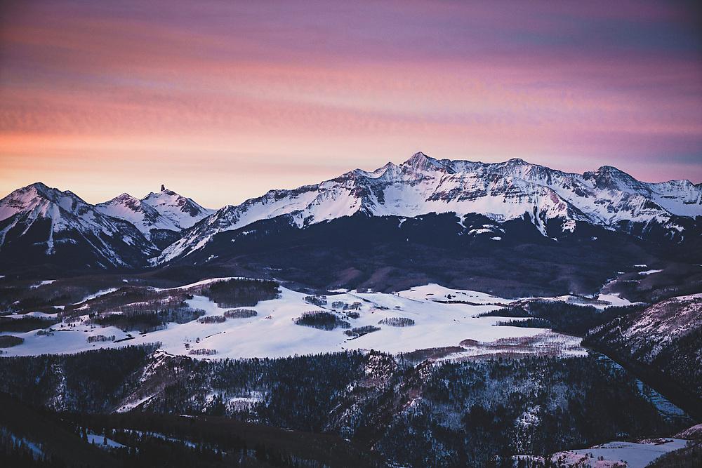 Alpenglow on the northern San Juan Mountains, Lizardhead, Mount Wilson, and Wilson Peak, early winter morning, Colorado.