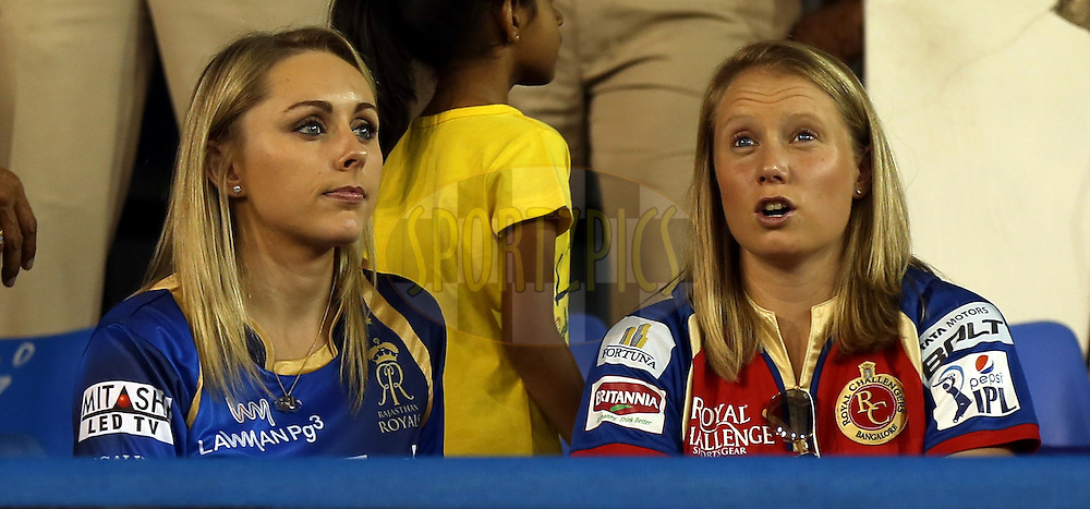 Alysa Healy fiance of  Royal Challengers Bangalore player Mitchell Starc (r) and Chene Wiese wife of  Royal Challengers Bangalore player David Wiese during match 22 of the Pepsi IPL 2015 (Indian Premier League) between The Rajasthan Royals and The Royal Challengers Bangalore held at the Sardar Patel Stadium in Ahmedabad , India on the 24th April 2015.<br /> <br /> Photo by:  Sandeep Shetty / SPORTZPICS / IPL
