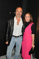 PETER SHALSON and MONIKA CSUTAK at the Audemars Piguet Royal Oak Offshore 42mm Party held at Victoria House, Bloomsbury Square, London on 23rd April 2014.