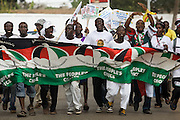 Supporters of the National Democratic Congress (NDC), Ghana's official opposition party, hold a banner as they arrive at a rally in Tema, roughly 30km east of Ghana's capital Accra on Friday December 5, 2008. Ghanaians are voting in a presidential election on December 7 as incumbent John Agyekum Kufuor, leader of the New Patriotic Party (NPP),  is to step down after ruling for 2 consecutive 4-year terms.