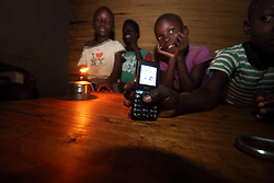 A family living close to the MMS clinic in Angiya using Kerosene lamps as they have no electricity.  They charge their phones in other locations, sometimes paying 20 shillings to charge. SAHFA baseline survey visit to the MMS Angiya Clinic., Homa Bay County, Kenya.  SAHFA Kenya © April 2019