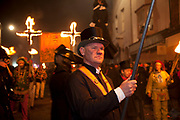 Lewes, UK. Monday 5th November 2012. Members carry burning torches on Bonfire Night celebration in the town of Lewes, East Sussex, UK which form the largest and most famous Guy Fawkes Night festivities. Held on 5 November, the event not only marks the date of the uncovering of the Gunpowder Treason and Plot in 1605, but also commemorates the memory of the 17 Protestant martyrs from the town burnt at the stake for their faith during the Marian Persecutions of 1555–57. There are six bonfire societies putting on parades involving some 3,000 people.