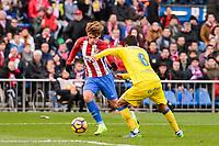 Atletico de Madrid Antoine Griezmann and UD Las Palmas Angel Montero during La Liga match between Atletico de Madrid and UD Las Palmas at Vicente Calderon Stadium in Madrid, Spain. December 17, 2016. (ALTERPHOTOS/BorjaB.Hojas)