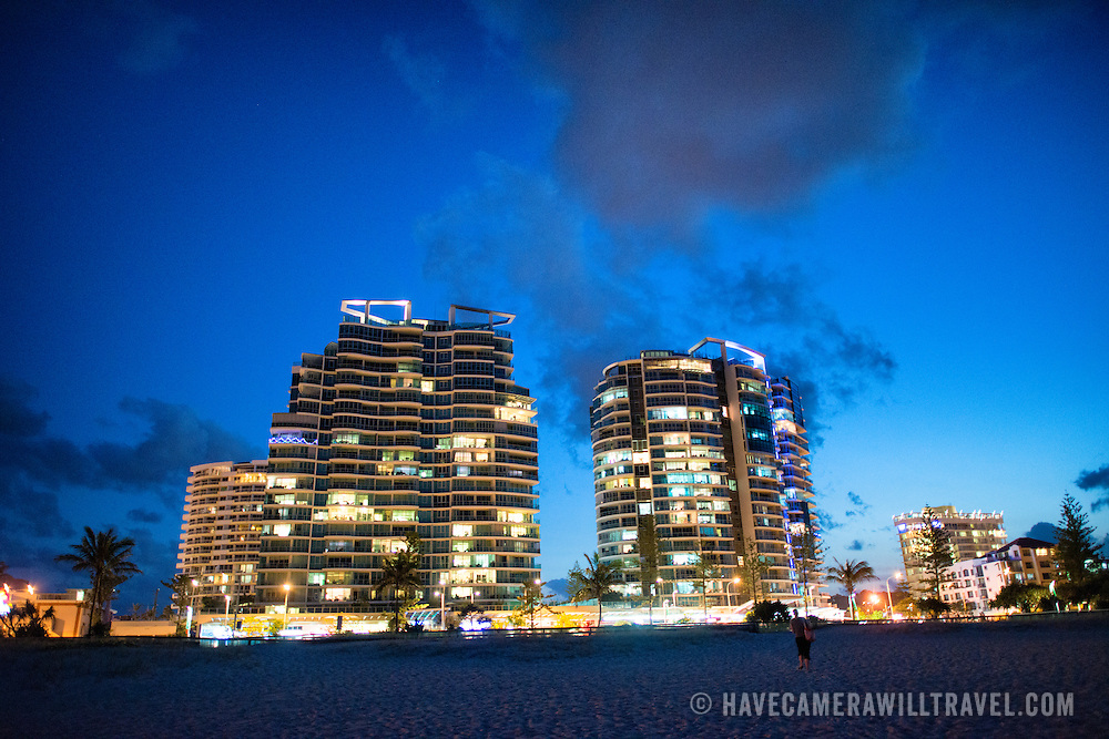 "Holiday unit buildings on Coolangatta's skyline at dusk. Sometimes paired as ""Twin Towns,"" Coolangatta and Tweed Heads, on the southern end of the Gold Coast, straddle the Queensland-New South Wales border."