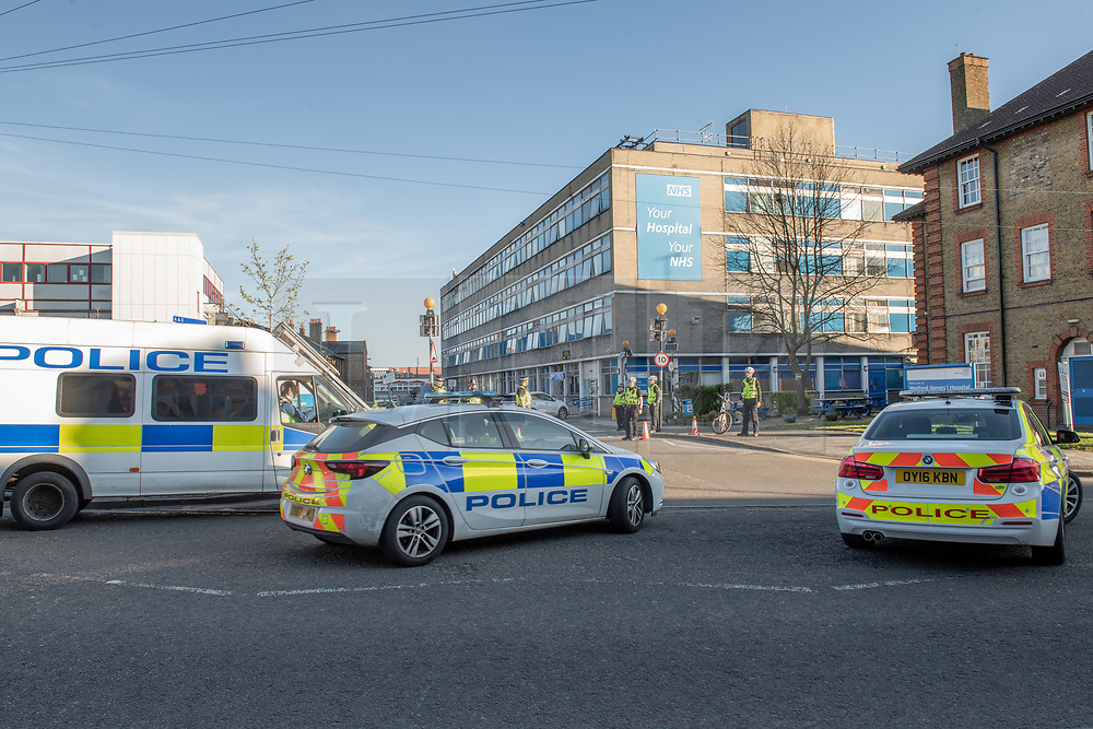 """© Licensed to London News Pictures. 04/04/2020. Watford, UK. Police stand guard at entrances to Watford General Hospital after a critical incident was declared. A statement released said: """"As a result of a technical issue with our individual hospital's oxygen equipment, which does not pose any risk to our patients, West Herts Hospitals NHS Trust declared a critical incident on Saturday April 4 and has asked that people do not attend Watford General Hospital. A small number of patients are being transferred to other hospitals in the area, with each patient being fully assessed in line with existing safety guidelines before they are moved."""" Photo credit: Peter Manning/LNP"""
