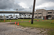 Refrigerator trucks  outside of New Orleans Coroner's Office on May. 25, 2020, A couple of days before the USA surpasses 100k dead from COVID-19.