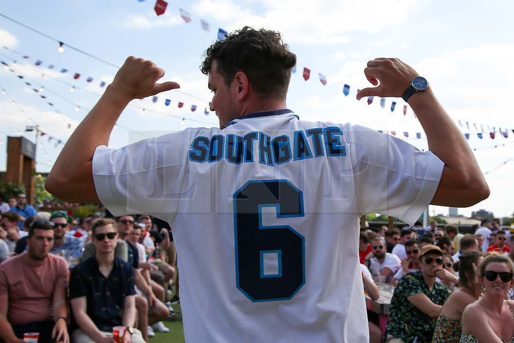 © Licensed to London News Pictures. 13/06/2021. London, UK. A fans wearing 'Southgate' shirt during the England v Croatia at Skylight Rooftop, Tobacco Dock in London, in England's opening Euro 2020 game. Photo credit: Dinendra Haria/LNP