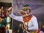 "29 APRIL 2017 - MINNEAPOLIS, MINNESOTA: Men wear Khon masks perform a dance from the Ramakien (Thai version of the Indian epic, the Ramayana) during Songkran Uptown. Several thousand people attended Songkran Uptown on Hennepin Ave in Minneapolis for the city's first celebration of Songkran, the traditional Thai New Year. Events included a Thai parade, a performance of the Ramakien (the Thai version of the Indian Ramayana), a ""Ladyboy"" (drag queen) show, and Thai street food.     PHOTO BY JACK KURTZ"