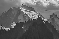 Standing at 4,808 m (15,774 ft) high, Mont Blanc is the highest point in Western Europe. Dozens of glaciers encircle the massif, with their ice covering a total area of 170 km² (42 mi²). The peak with the tower on the upper right is Aiguille du Midi, which is accessible by a cable car.