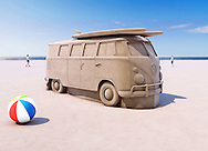 VW Van Sand Sculpture on beach with people and sea in distance. Beach ball in foreground.