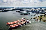 Nederland, Zuid-Holland, Rotterdam, 10-06-2015; 7e Petroleumhaven met Vopak Terminal Europoort in de achtergrond. In de voorgrond de crude oil tankers Hilda Knutsen en Navion Hispania (met bunker schip aan haar zijde).<br /> 7th Petroleum port with crude oil tankers.<br /> luchtfoto (toeslag op standard tarieven);<br /> aerial photo (additional fee required);<br /> copyright foto/photo Siebe Swart