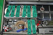 Fire fighter's equipment arranged on a rack