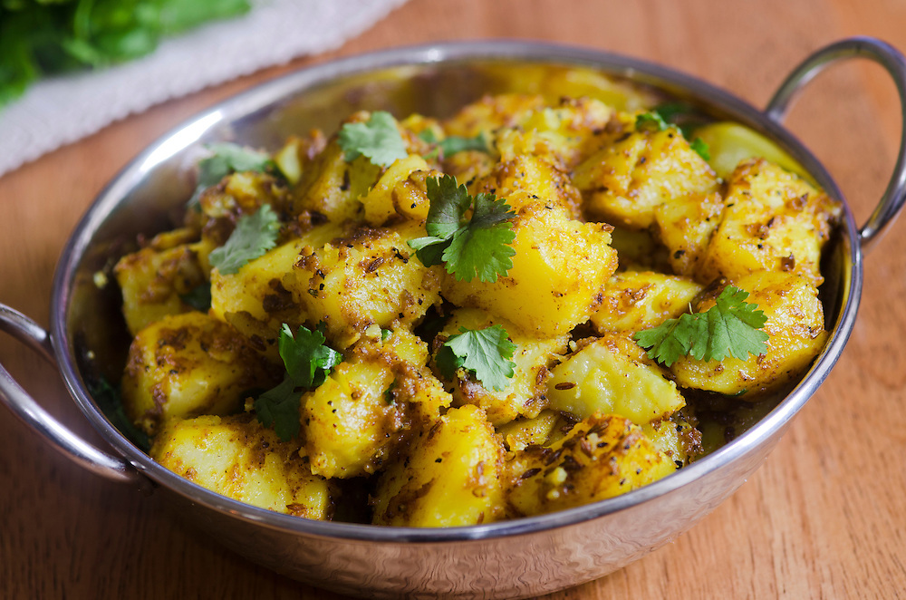 Indian spiced potato curry topped with coriander