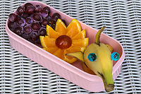 Character Bentos or kyaraben are elaborately decorated and arranged Japanese lunch boxes. To amuse children, the characters come from popular TV shows, movies, animation favorites, and cute animals. The thinking behind them is this: decorating a child's lunch makes the kid interested in a variety of food and to encourage a wider range of eating habits.   Kids at school admire each others lunches, and gain a kind of status with the coolest lunch boxes, causing rivalry among both kids and mothers.  This has evolved to the point where national contests are held now for best lunch boxes, judged on design and nutritional values.  Even cook books are being published on the subject.  Some of these bentos are truly works of art, with great attention to detail.  Others kind of resemble a dogs dinner.