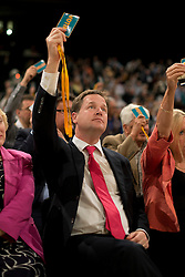 © London News Pictures. 25/09/2012. Brighton, UK.  Leader of the Liberal Democrats, Nick Clegg voting on a motion before Chief Secretary to the Treasury, Danny Alexander delivered his speech on day 4 of the Liberal Democrat Conference in Brighton on September 25, 2012. Photo credit : Ben Cawthra/LNP.