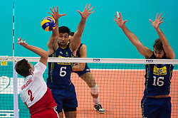 21-09-2014 POL: FIVB WK Finale Polen - Brazilie, Katowice<br /> Angriff Michal Winiarski (#2 POL) - Block / Doppelblock Leandro Visotto Neves (#6 BRA), Lucas Saatkamp (#16 BRA)<br /> <br /> ***NETHERLANDS ONLY***