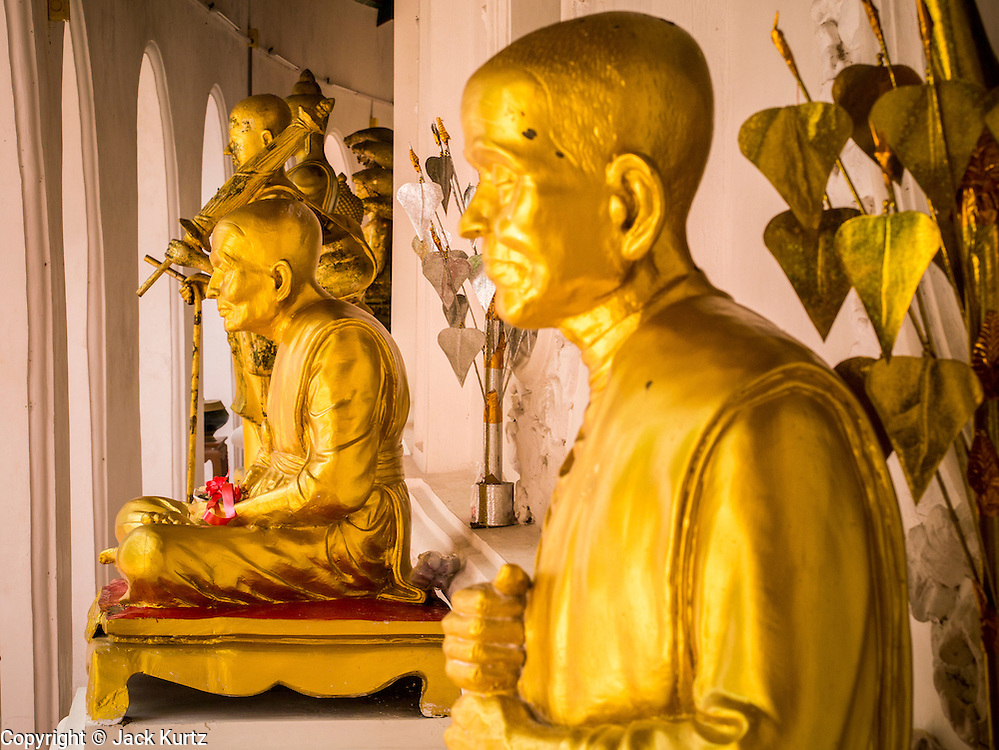 12 OCTOBER 2012 - NAKHON PATHOM, NAKHON PATHOM, THAILAND:  Statues of deceased monks surrounding Phra Pathom Chedi in Nakhon Pathom. The Phra Pathom Chedi in Nakhon Pathom was commissioned by King Mongkut and completed by King Chulalongkorn in 1870. The chedi is 127 meters tall and is one of the tallest pagodas in the world. It is located in the center of the city of Nakhon Pathom and has been an important Buddhist center since the 6th century. According to local history, Nakhon Pathom is where Buddhism first came to Thailand.     PHOTO BY JACK KURTZ