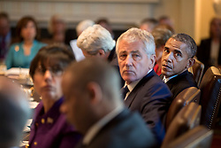 President Barack Obama, Defense Secretary Chuck Hagel and Commerce Secretary Penny Pritzker turn to listen during Cabinet meeting in the Cabinet Room of the White House, Feb. 3, 2015. (Official White House Photo by Pete Souza)<br /> <br /> This official White House photograph is being made available only for publication by news organizations and/or for personal use printing by the subject(s) of the photograph. The photograph may not be manipulated in any way and may not be used in commercial or political materials, advertisements, emails, products, promotions that in any way suggests approval or endorsement of the President, the First Family, or the White House.