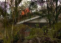 July 9, 2018 - Pahoa, Hawaii, U.S - Fissure 8 erupts in the distance over a home in the Leilani Estates Subdivision as the Kilauea Volcano east rift zone eruption continues Sunday, June 10, 2018, in Pahoa, Hawaii.  Photo by LE Baskow/LeftEyeImages (Credit Image: © L.E. Baskow via ZUMA Wire)
