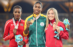 Gold medallist in the Women's 1500m Final South Africa's Caster Semenya (centre) alongside silver medallist Kenya's Beatrice Chepkoech (left) and bronze medallist Wales' Melissa Courtney at the Carrara Stadium during day seven of the 2018 Commonwealth Games in the Gold Coast, Australia.