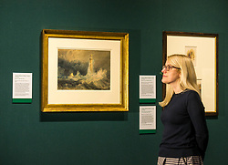 Pictured: Curator Charlotte Topsfield admires the Bell Rock lighthouse painting by Turner. Turner art exhibition. For more than a century the National Galleries of Scotland (NGS) have displayed an outstanding collection of Turner watercolours, from the 38 paintings bequeathed by Henry Vaughan in 1900. His will stipulated that the paintings should only be shown in January when daylight in Edinburgh is weak. The annual exhibition by artist Joseph Mallord William Turner (1775-1851) is supported by players of People's Postcode Lottery for the 7th year running. The focal point is a dramatic portrait of the Bell Rock lighthouse built by Robert Stevenson (1772-1850) which was commissioned 200 years ago by the lighthouse engineer to illustrate his book 'Account of the Building of Bell Rock Lighthouse'. Bell Rock is the oldest surviving rock lighthouse in the British Isles, first lit in 1811. It stands on a partially submerged reef near Angus, regarded by sailors as among the most dangerous places on the east coast of Scotland. The exhibition opens on New Year's Day at Scottish National Gallery and last for one month. 20 December 2018  <br /> <br /> Sally Anderson | EdinburghElitemedia.co.uk