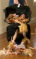 03 Jan, 2006. New Orleans, Louisiana.  Barbies return home. <br /> Items taken by a young girl during the mass evacuation of New Orleans finally return home. Barbies fall from a travel bag.<br /> Photo©; Charlie Varley/varleypix.com