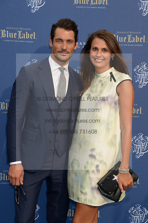 The Johnnie Walker Blue Label and David Gandy Drinks Reception aboard John Walker & Sons Voyager, St.Georges Stairs Tier, Butler's Wharf Pier, London, UK on 16th July 2013.<br /> Picture Shows:-David Gandy and Olivia Cole.