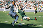 Portland Timbers defender Mike Chabala, right, attempts to block a cross by Los Angeles Galaxy defender Sean Franklin during the first half of an MLS soccer match, Sunday, June 17, 2012, in Carson, Calif. (AP Photo/Bret Hartman)
