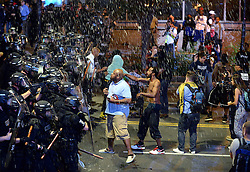 Debris falls upon Charlotte officers and protestors as officers began to push protestors from the intersection near the Epicentre in Charlotte, NC, USA, on Wednesday, Sept. 21, 2016. The protestors were rallying against the fatal shooting of Keith Lamont Scott by police on Tuesday evening in the University City area. Photo by Jeff Siner/Charlotte Observer/TNS/ABACAPRESS.COM