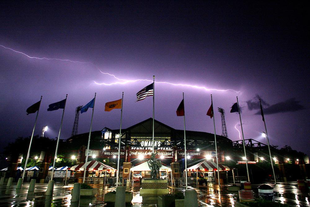 June 22, 2010; Omaha, NE, USA; Lightning illuminates the sky over Rosenblatt Stadium as game 8 of the 2010 College World Series featuring the Oklahoma Sooners and the Clemson Tigers is postponed due to rain and lightning. Mandatory Credit: Crystal LoGiudice-US PRESSWIRE.